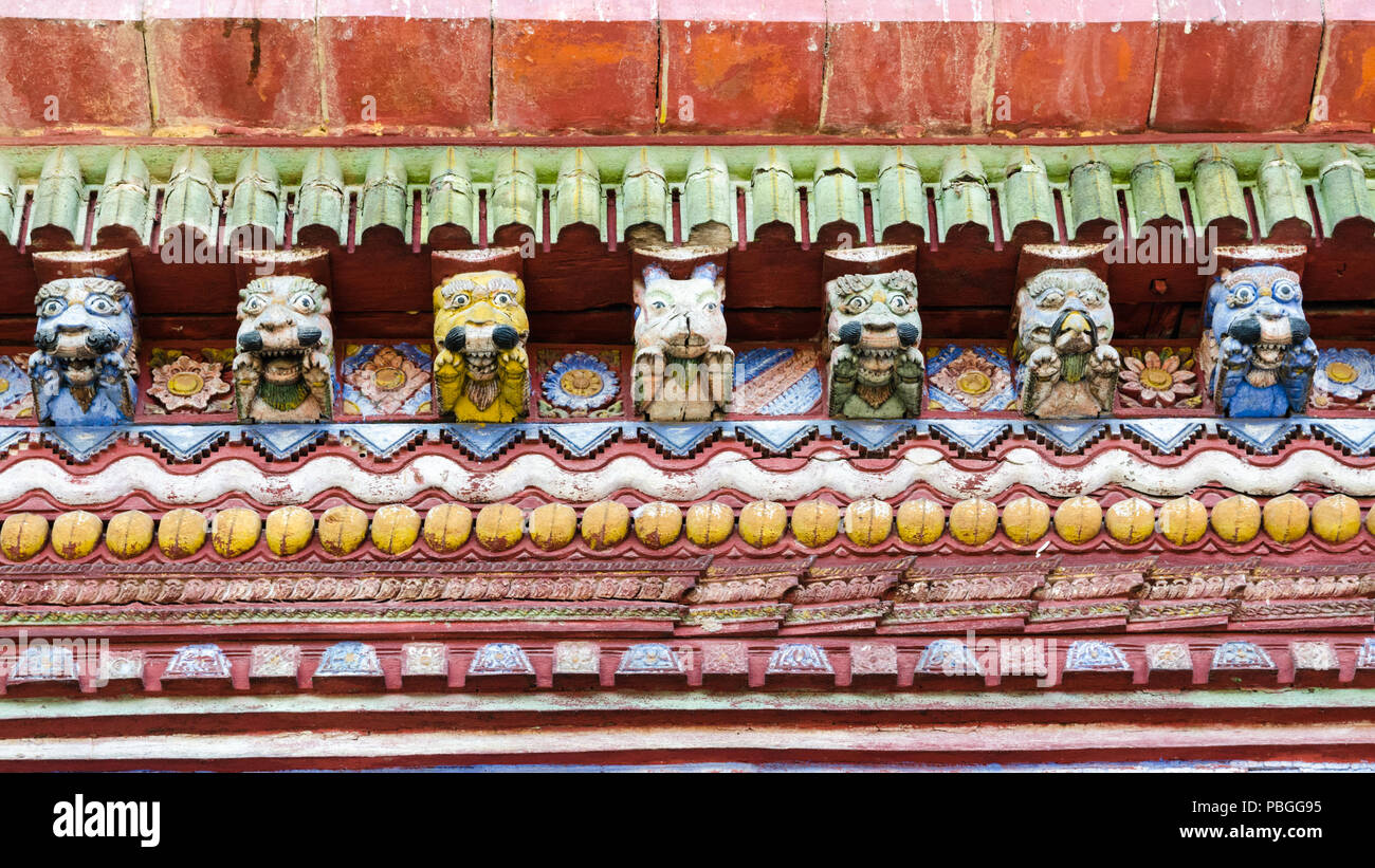 Detail of colorful wood carved faces of Changu Narayan temple, Nepal - Stock Image