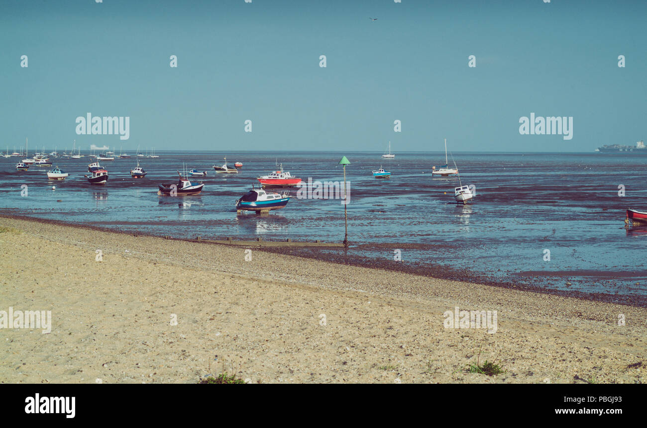 small boats photographed during low tide in Shoeburyness, Essex, UK Stock Photo