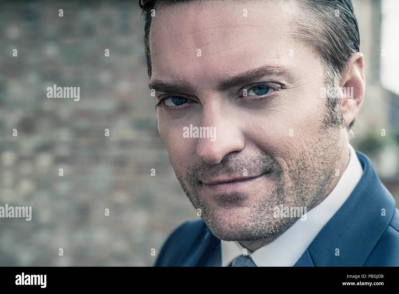 closeup portrait of a handsome man in a smart suit Stock Photo
