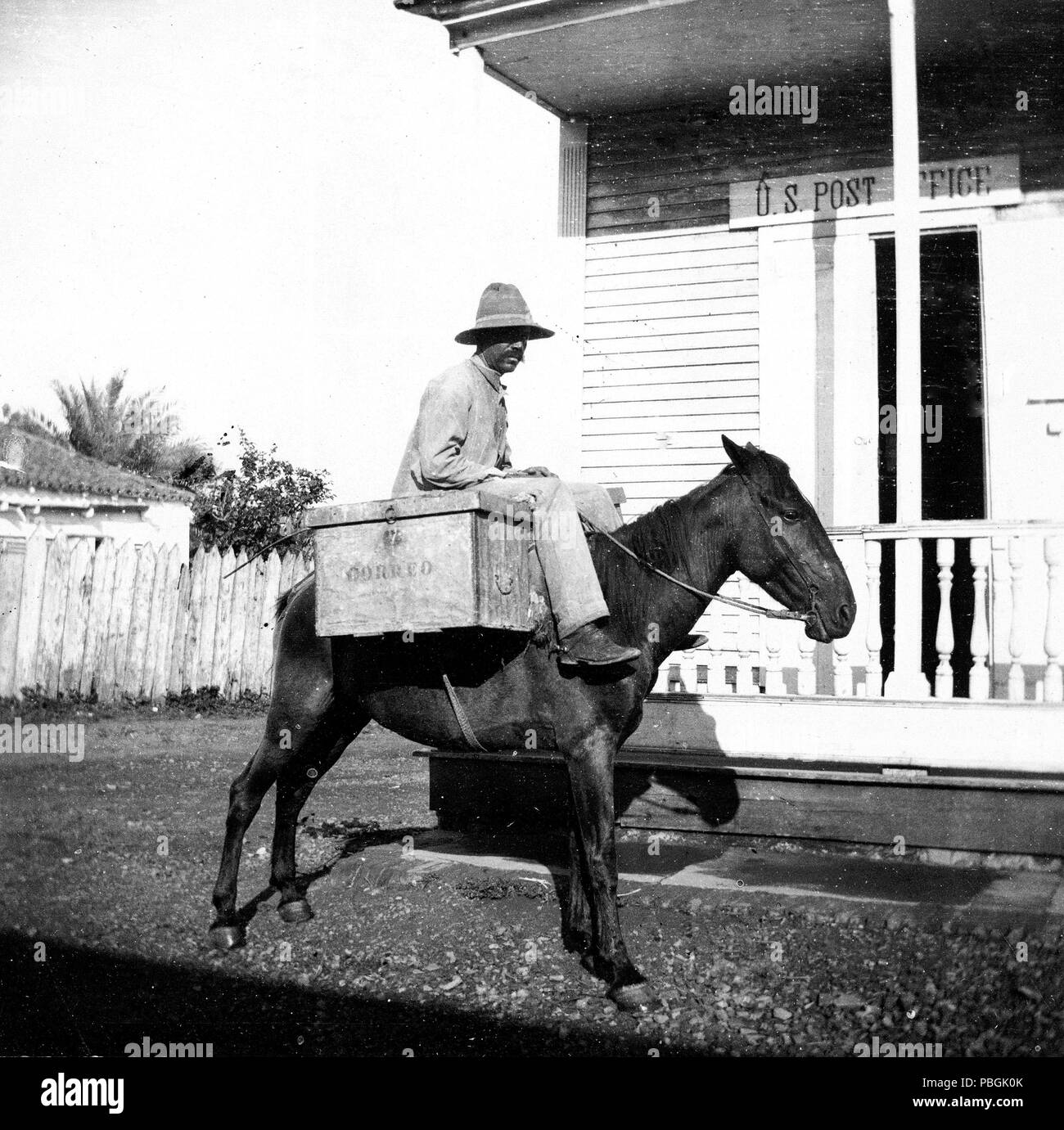 Man On Horse With Box Labeled Correo Outside Wooden U S Post Office Building 1890 1923 Puerto Rico Stock Photo Alamy