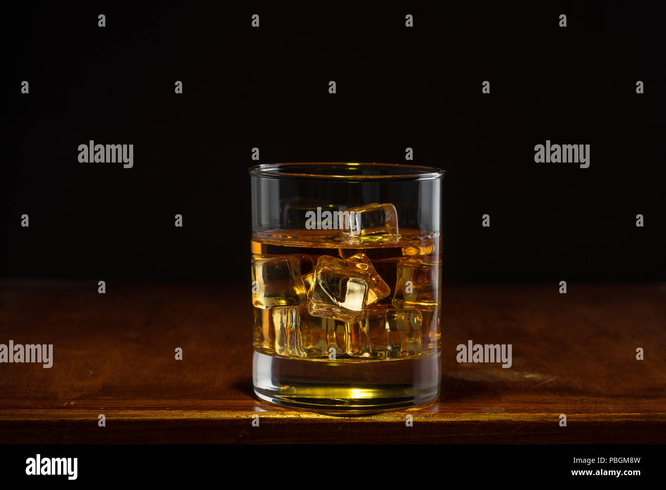 Bourbon whiskey on whiskey glass with rustic and dark theme Stock Photo
