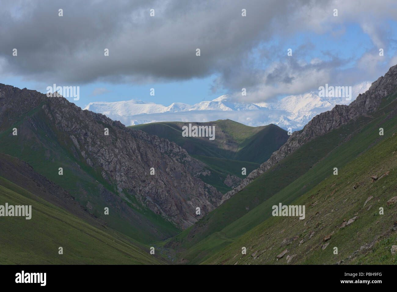 View of 7,000 metre Peak Lenin and the high Pamirs on the epic Heights of Alay route, Alay, Kyrgyzstan Stock Photo