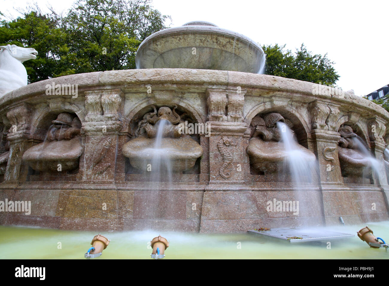 The Wittelsbacher fountain at the Lenbachplatz in Munich, Germany - Stock Image