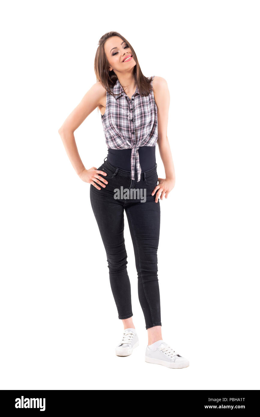 Cute pretty teenage girl posing in checkered shirt tied in knot full body length isolated on white background