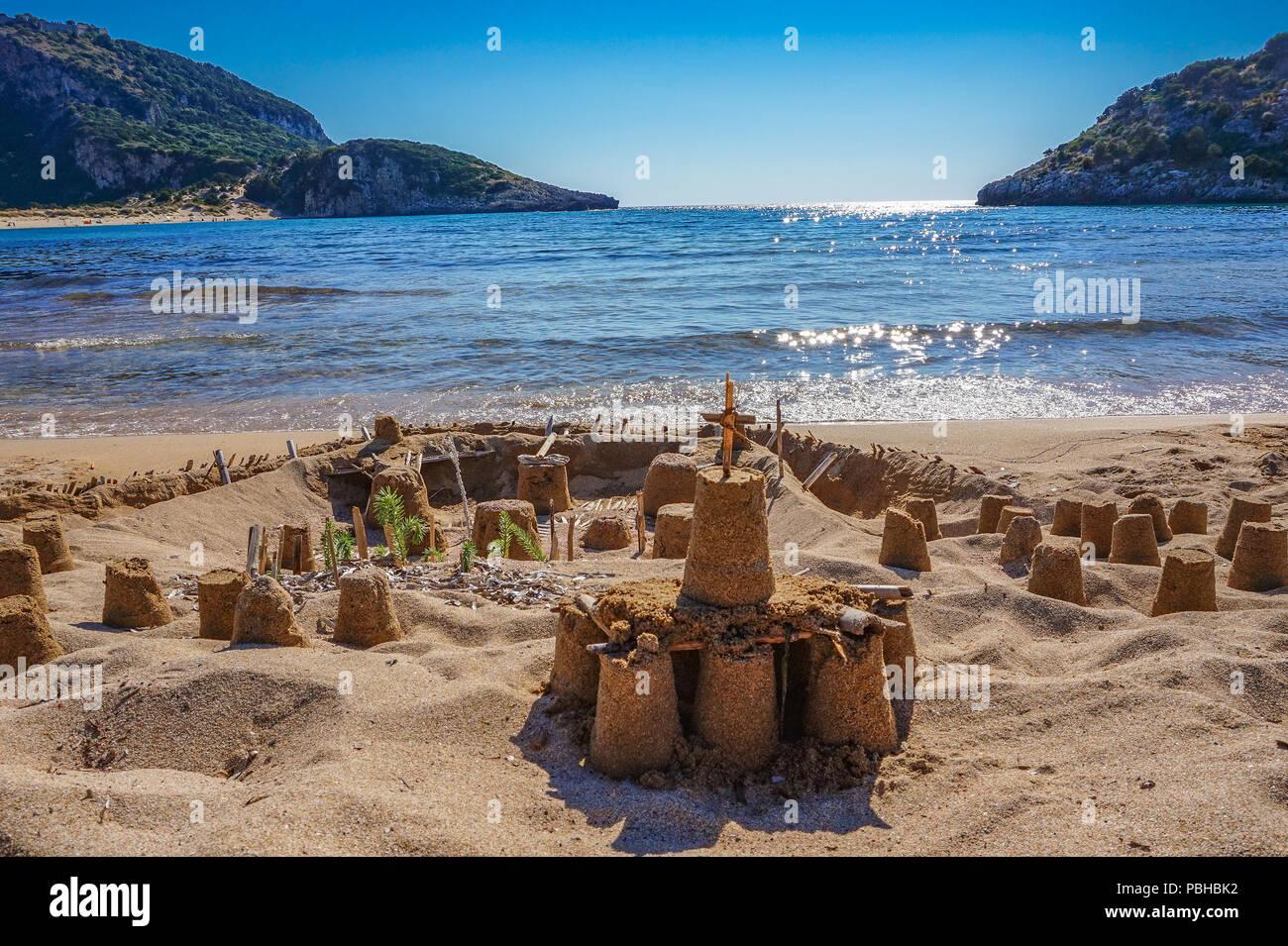 Castle made of sand on the beautiful beach of Voidokilia, Messenia, Greece - Stock Image