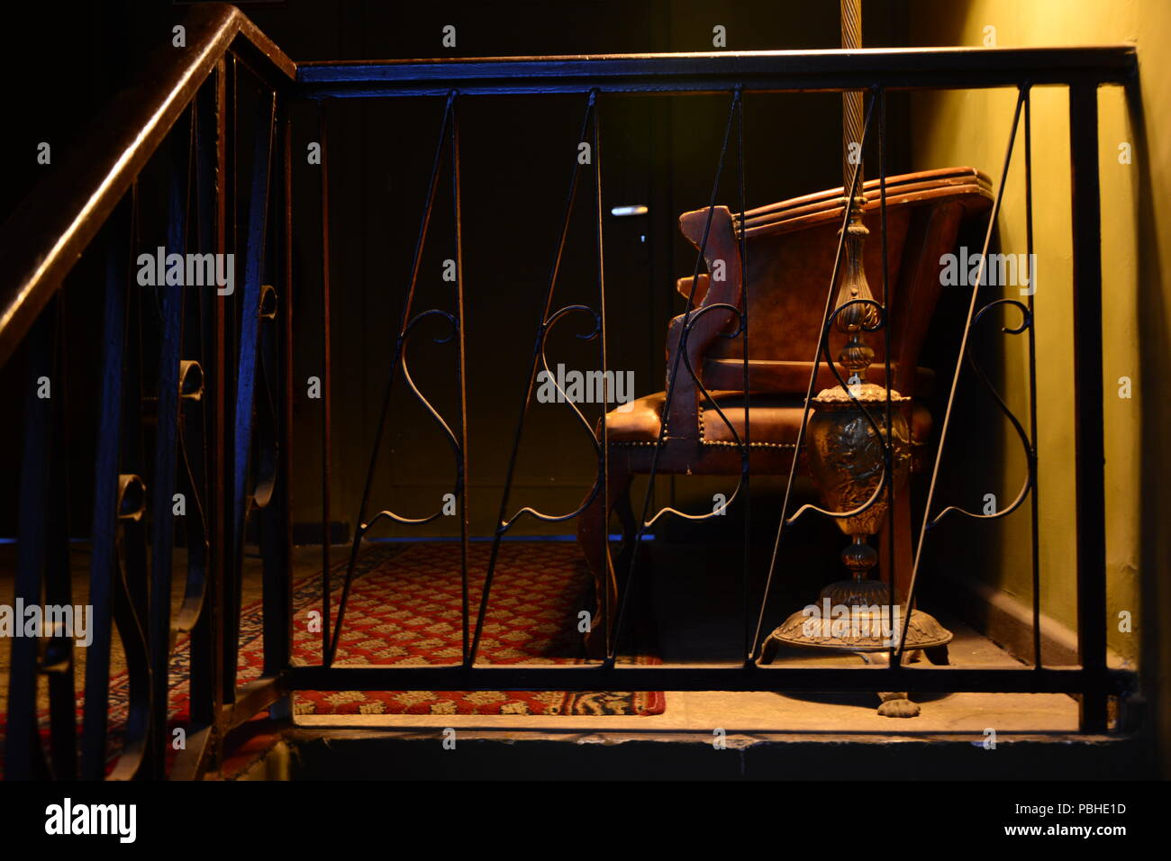 empty chair dark house night eastern house vacant seat old building spotlight secret remembrance abandoned sad loyal spooky scary weired interior - Stock Image