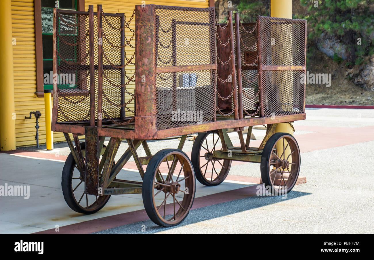 Vintage Luggage Cart At Small Train Depot - Stock Image