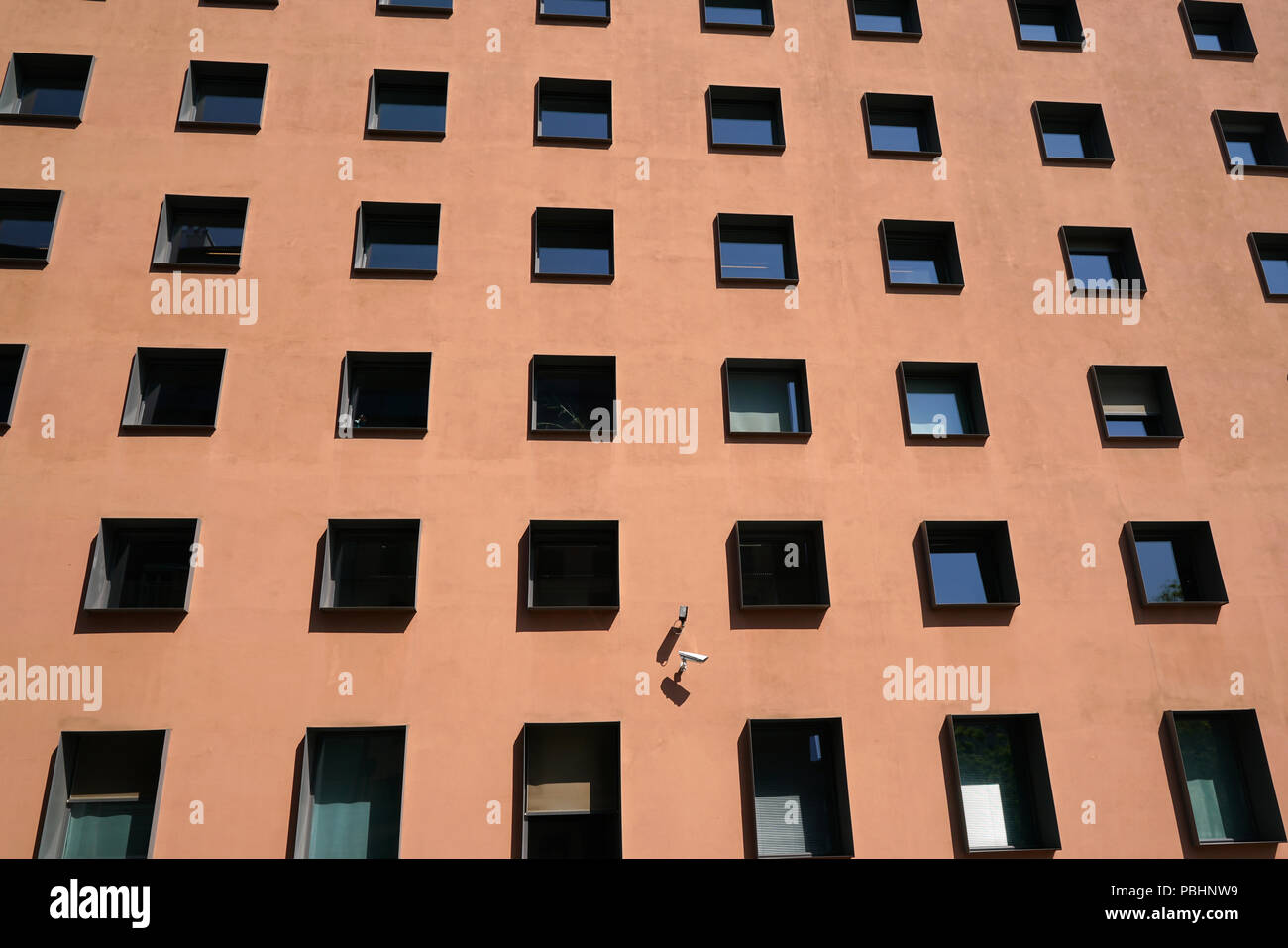 Facade of an office building in Berlin with security camera - Stock Image