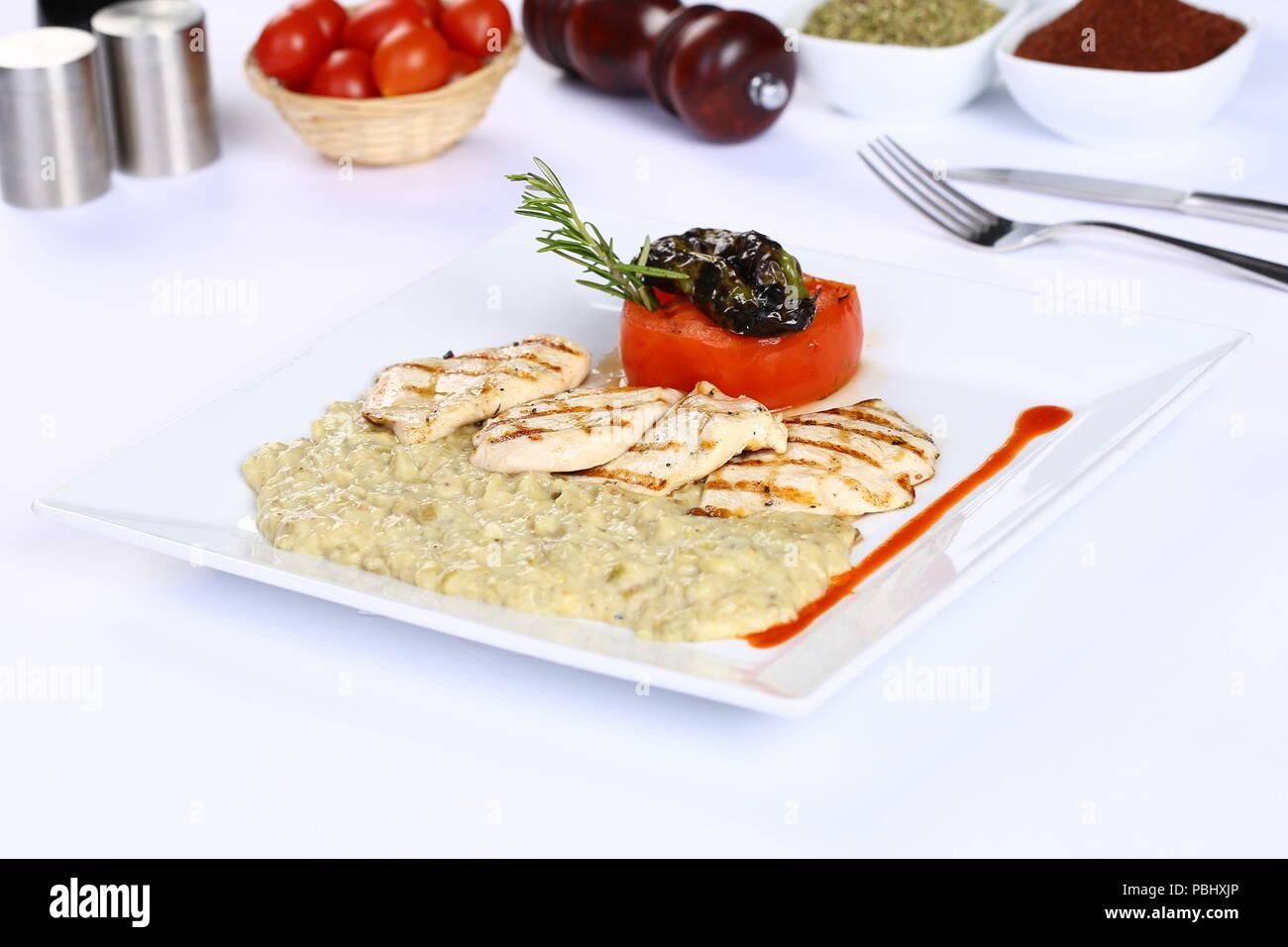 Grill fish fillet with tarator, humus - Stock Image
