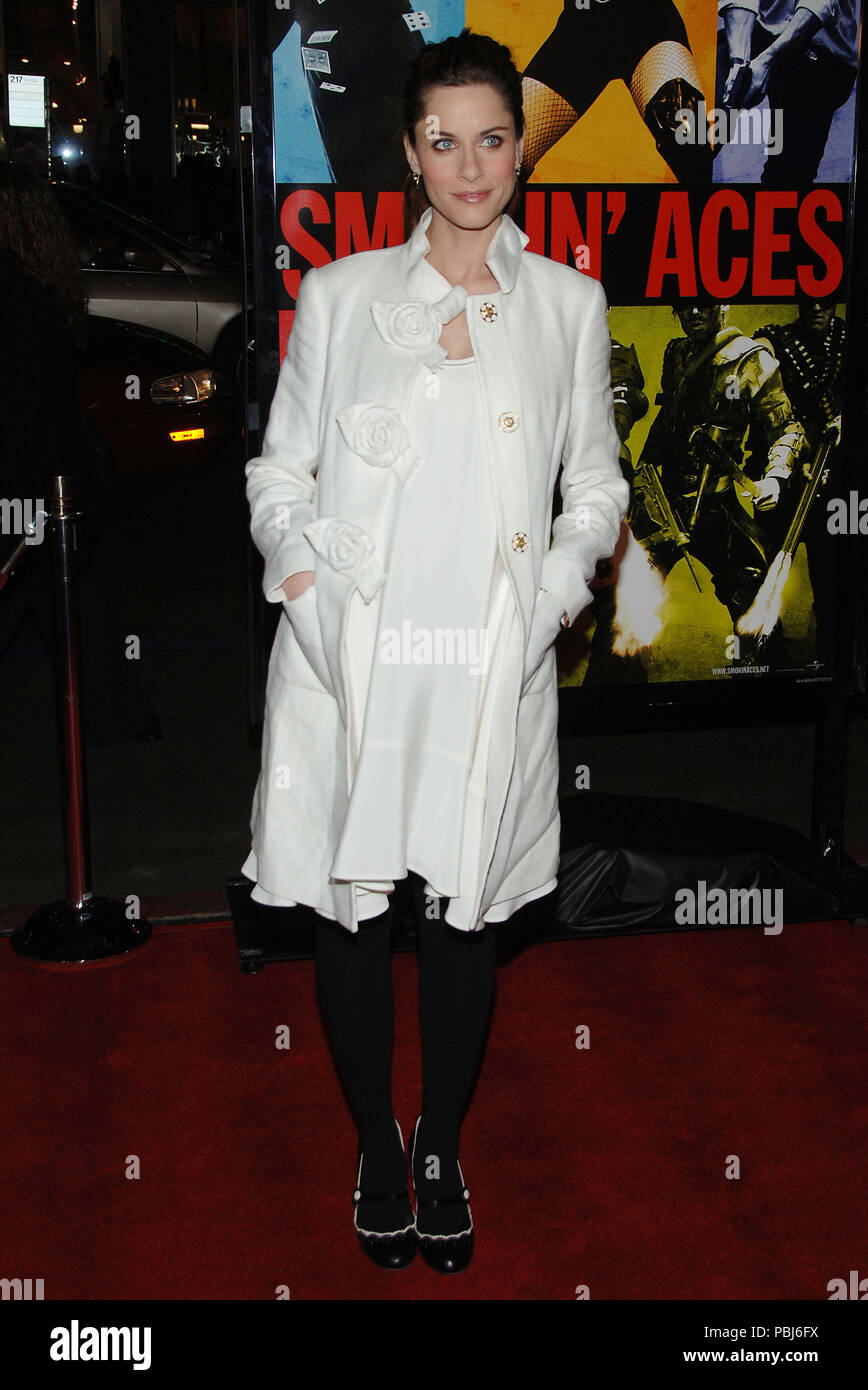 Amanda Peet arriving at the Smokin' Aces at the Chinese Theatre In Los Angeles. January 18, 2007.  smile full length white coatPeetAmanda007 Red Carpet Event, Vertical, USA, Film Industry, Celebrities,  Photography, Bestof, Arts Culture and Entertainment, Topix Celebrities fashion /  Vertical, Best of, Event in Hollywood Life - California,  Red Carpet and backstage, USA, Film Industry, Celebrities,  movie celebrities, TV celebrities, Music celebrities, Photography, Bestof, Arts Culture and Entertainment,  Topix, vertical, one person,, from the year , 2007, inquiry tsuni@Gamma-USA.com Fashion - - Stock Image