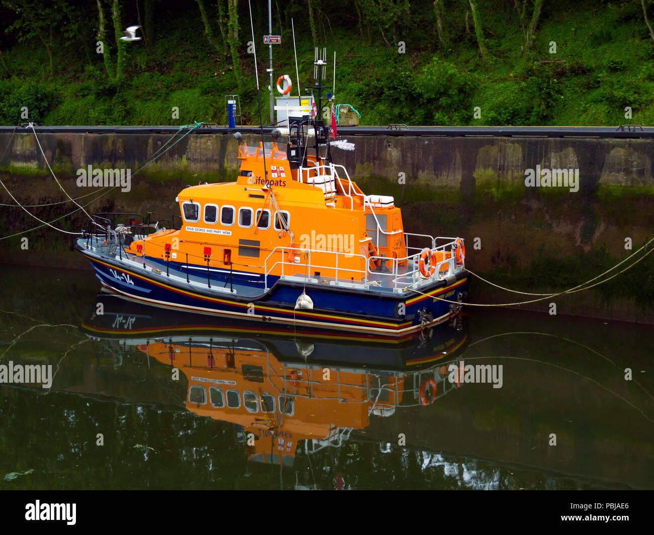 "The  Trent class Lifeboat 14-14 ""George and Mary Webb""  marked ""Whitby Lifeboat "" in Eyemouth Harbour Scotland Stock Photo"