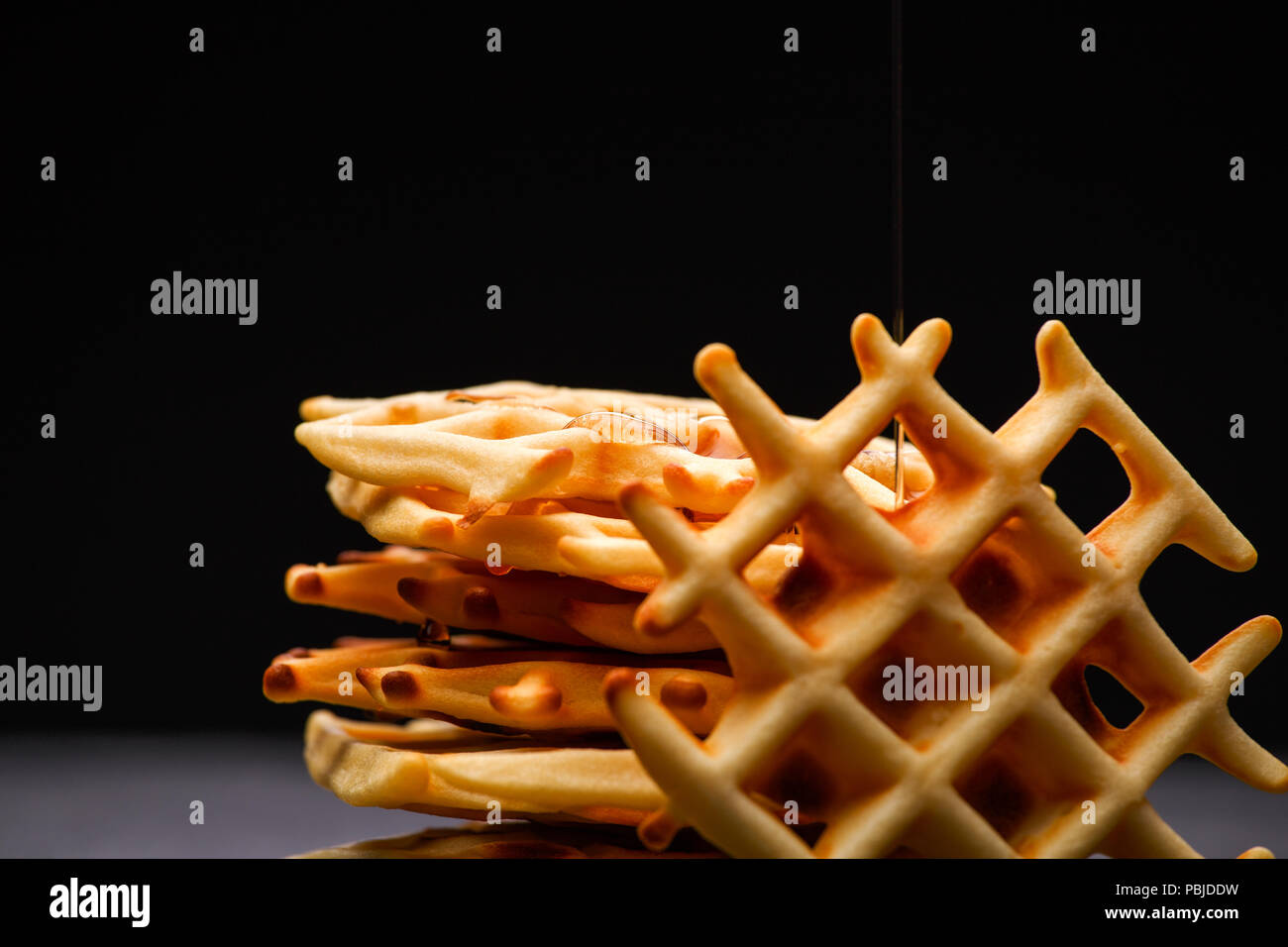 Photo of Viennese wafers on black background - Stock Image