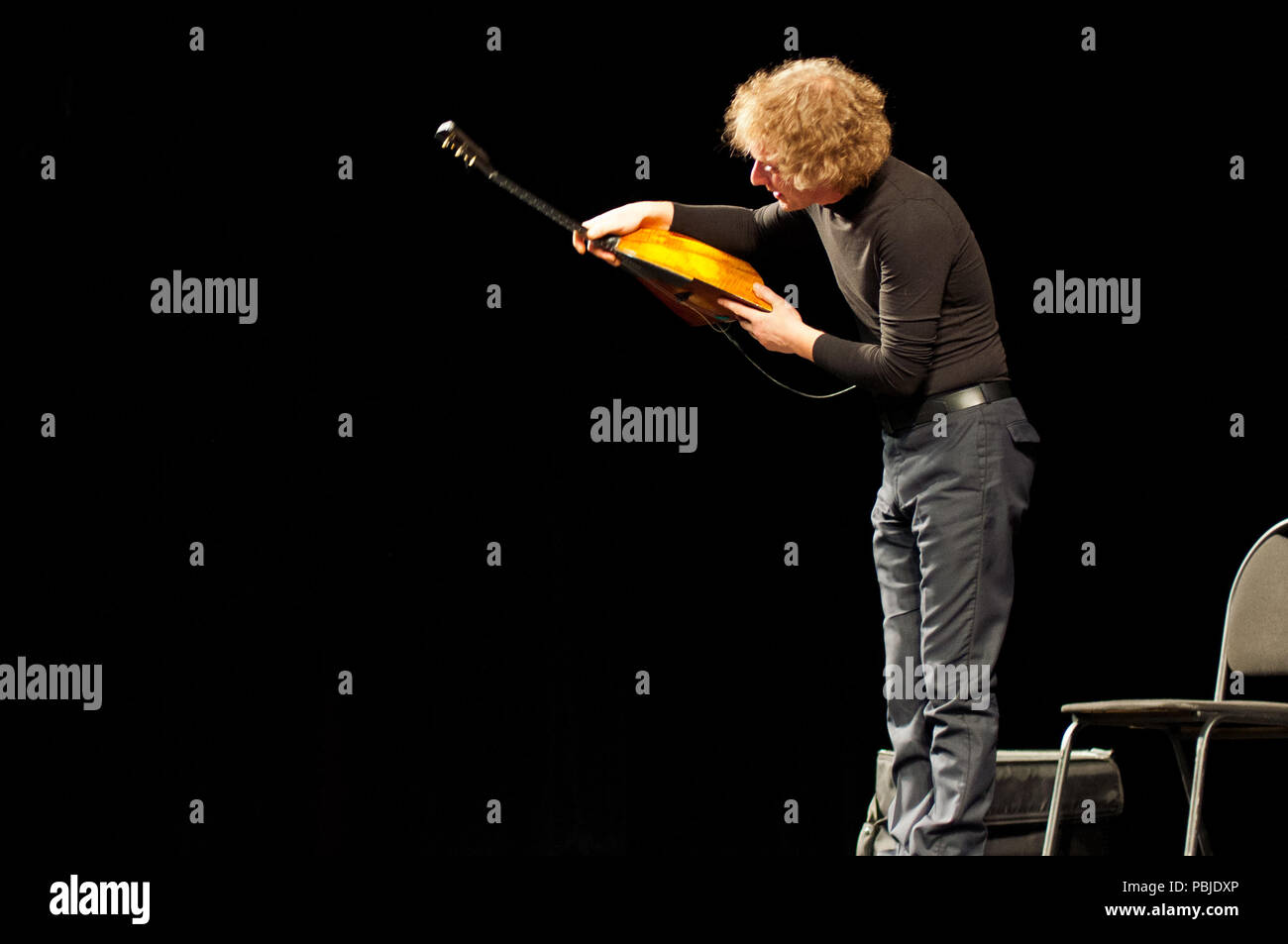MOSCOW, RUSSIA - NOVEMBER 10, 2011: Virtuoso-balalaika player Alexei Arkhipovsky plays at the concert. - Stock Image