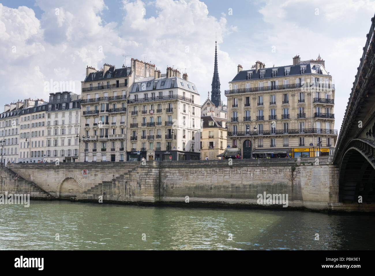 View from the Parc des Rives de Seine, next to the Pont d'Arcole bridge towards the Quai aux Fleurs on the left bank, Paris, France. - Stock Image