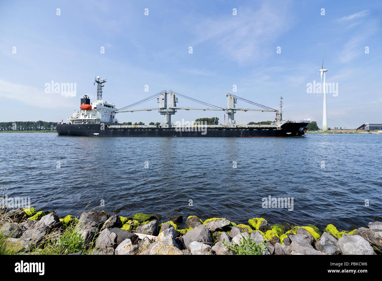 general cargo vessel shipping on canal - Stock Image
