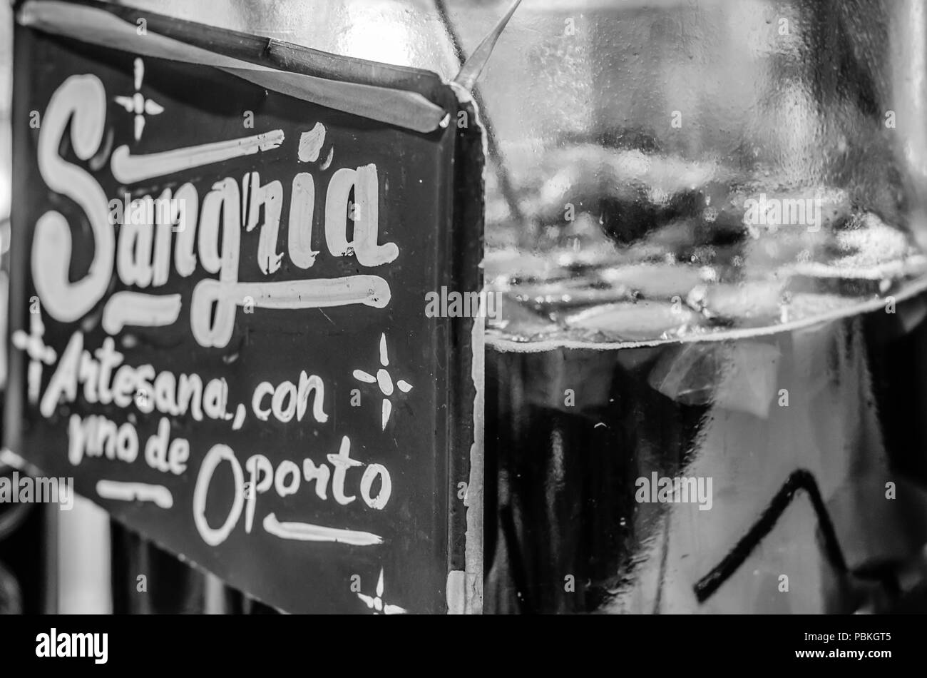 MADRID, SPAIN - AUGUST 27, 2017:  Artisan port wine sangria served at a market stand inside the historical 'Mercado de San Miguel' (Market of San Migu - Stock Image