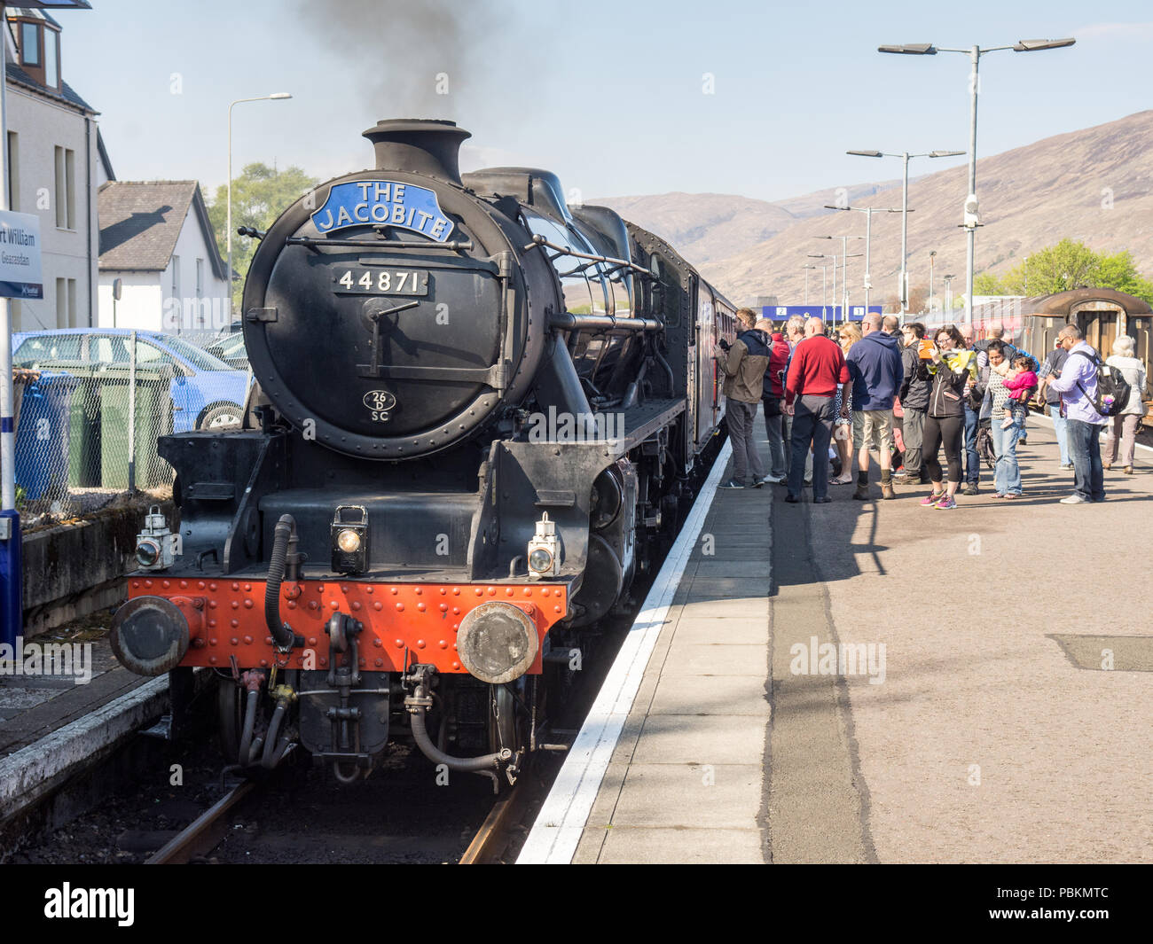 Fort William, Scotland, UK - May 11, 2016: A crowd of tourists gather around the Jacobite steam team at Fort William Station in the West Highlands of  Stock Photo