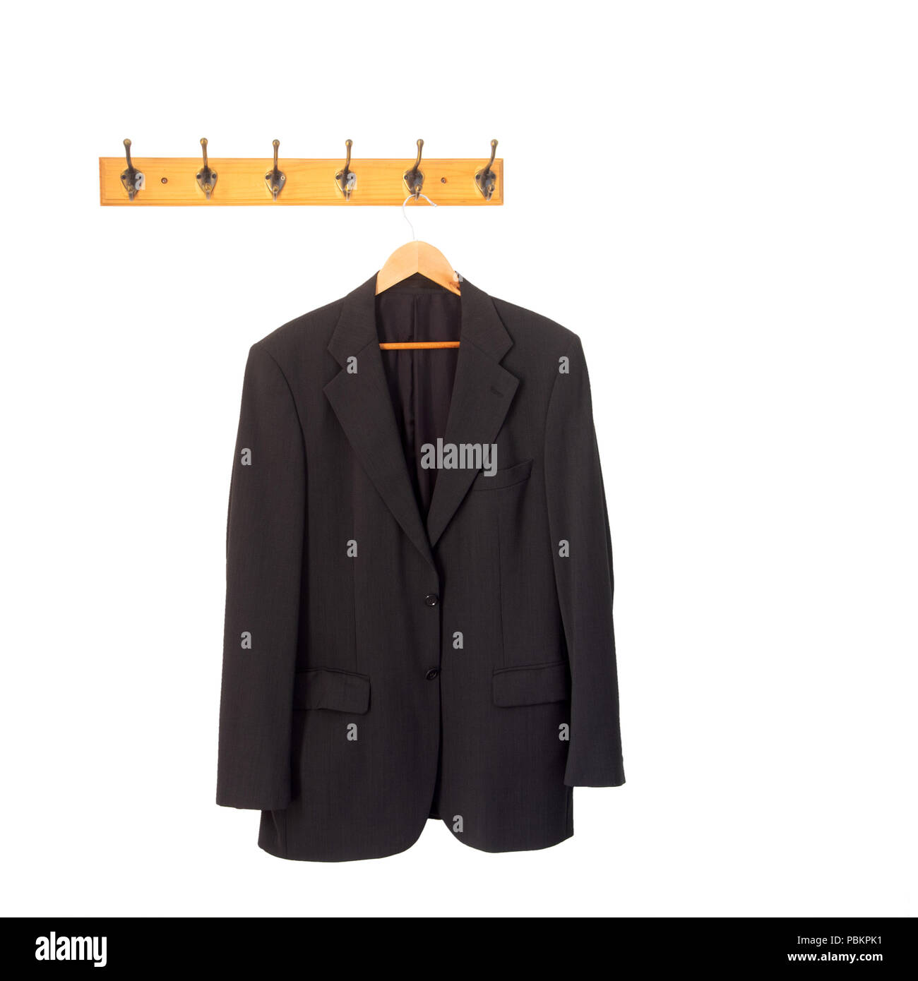 Mans grey suit jacket on hanger, hung up and isolated on white. Retirement, redundancy concept or working late. - Stock Image