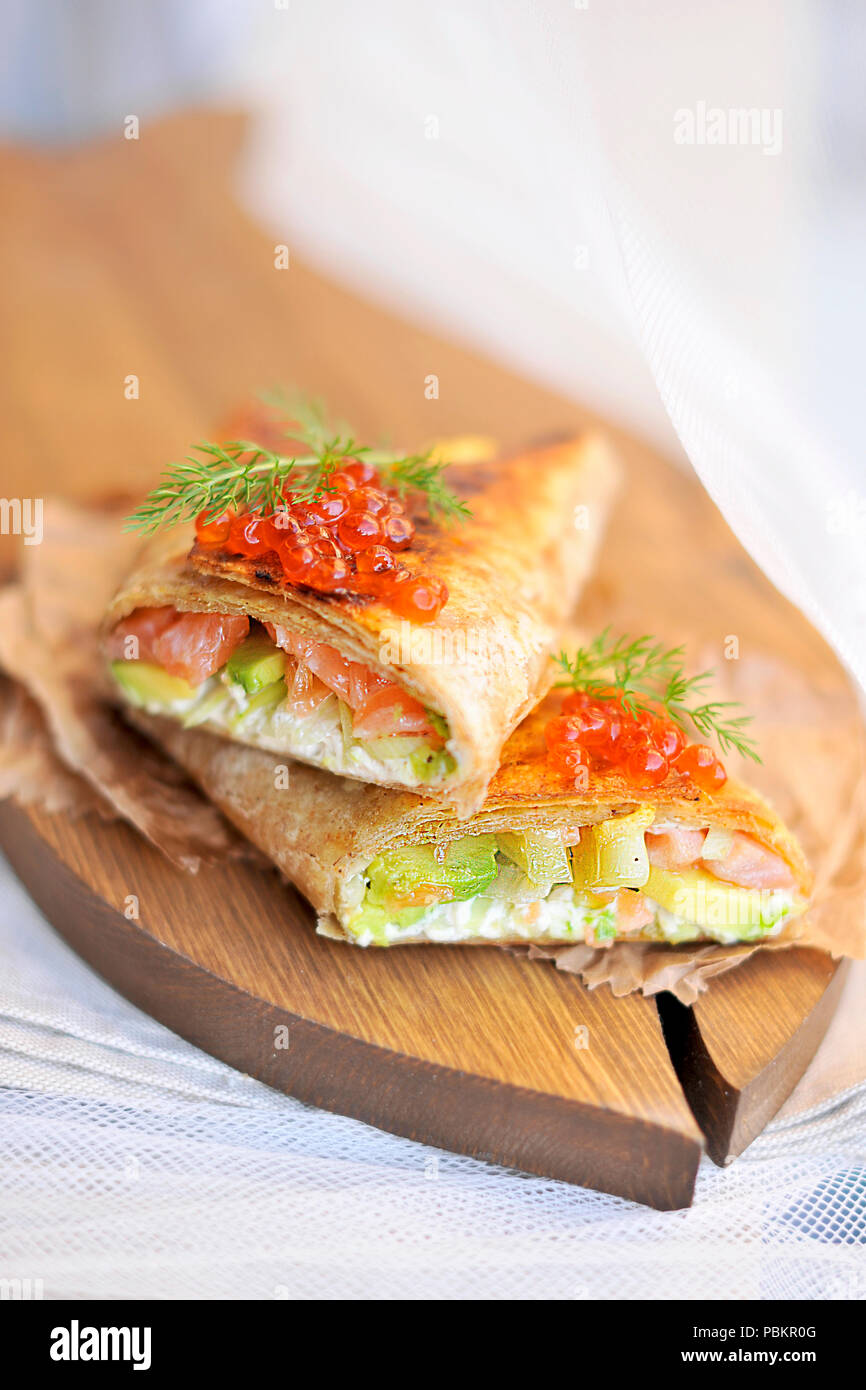 roll of bread with fish and caviar, delicious seafood. Asian cuisine. Copy space - Stock Image