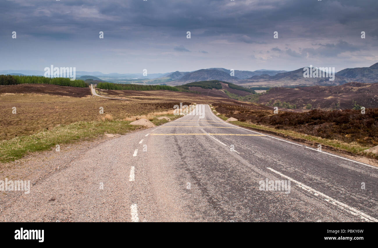 The long straight 18th century military road of General George Wade crosses the remote undulating landscape of Stratherrick in the Highlands of Scotla - Stock Image