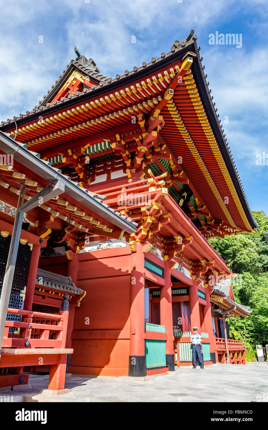 Ornate carvings painted bright red and yellow in the Hase-dera Buddhist Temple, Kamakura near Tokyo, Japan. - Stock Image