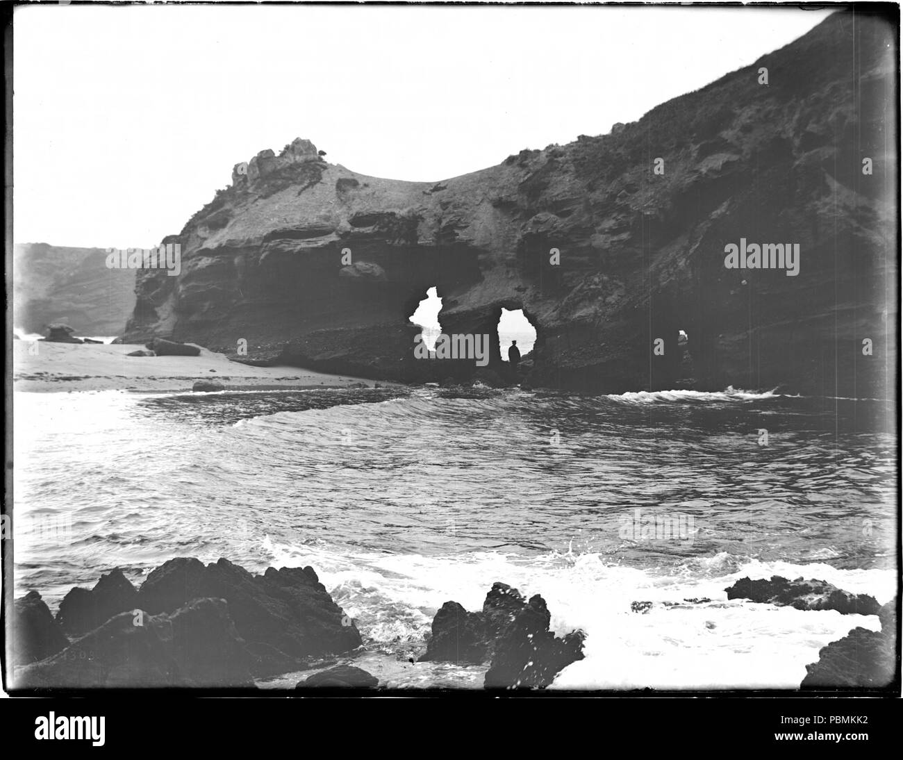 """882 Laguna Beach surf and the rock arches at Capistrano Beach, """"The Lady of the Sea"""", 1910 (CHS-1303) Stock Photo"""