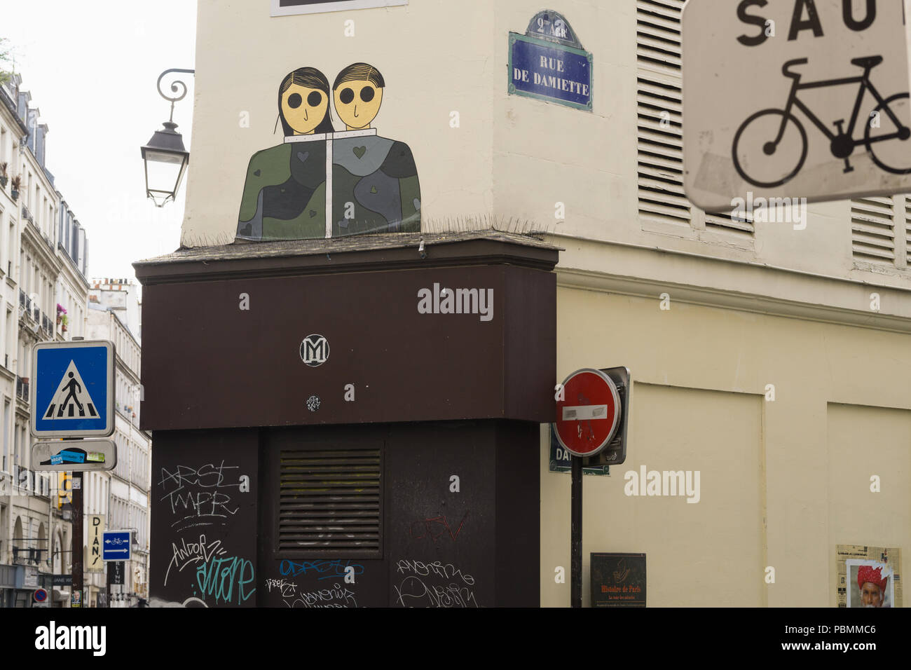 Stencil graffiti on a Parisian building, France. - Stock Image