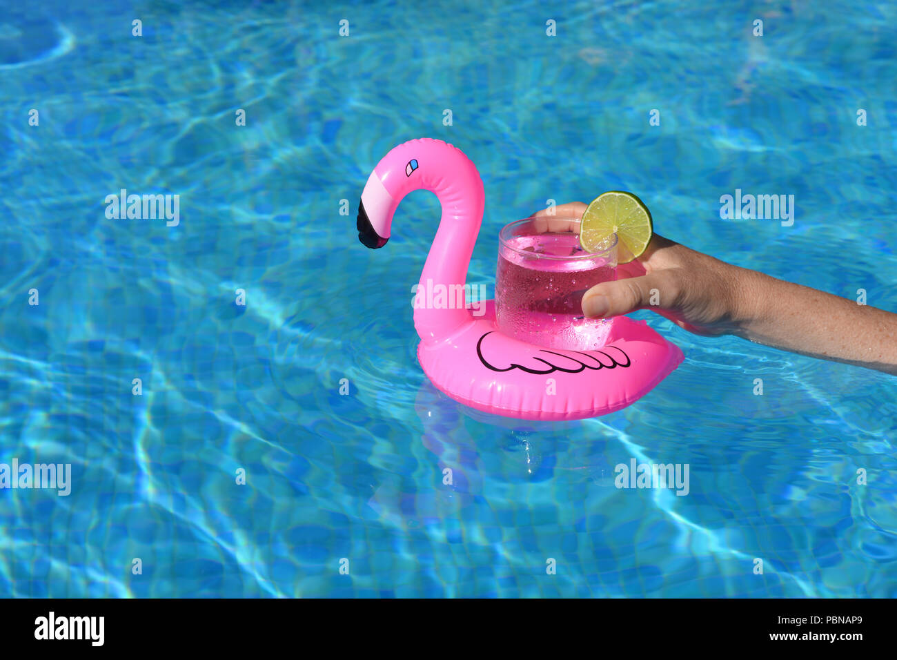 Summer Vibes Womans Hand With A Cold Drink In An Inflatable Pink
