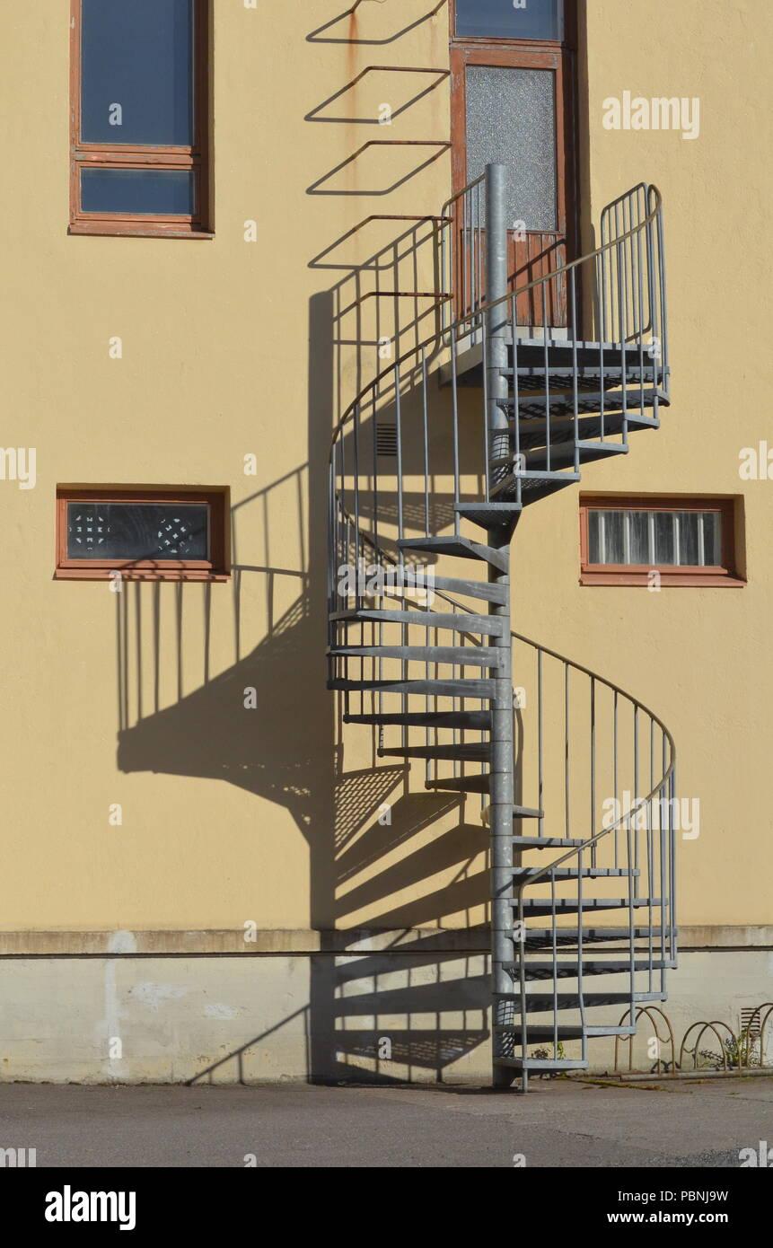 Spiral  steel fire escape - Stock Image