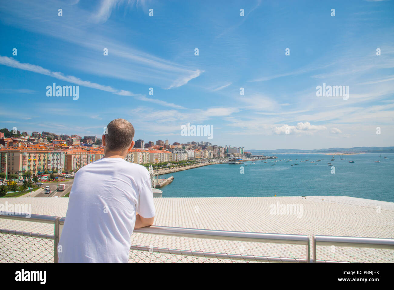 Man at the viewpoint over the city. Botin Center, Santander, Spain. - Stock Image