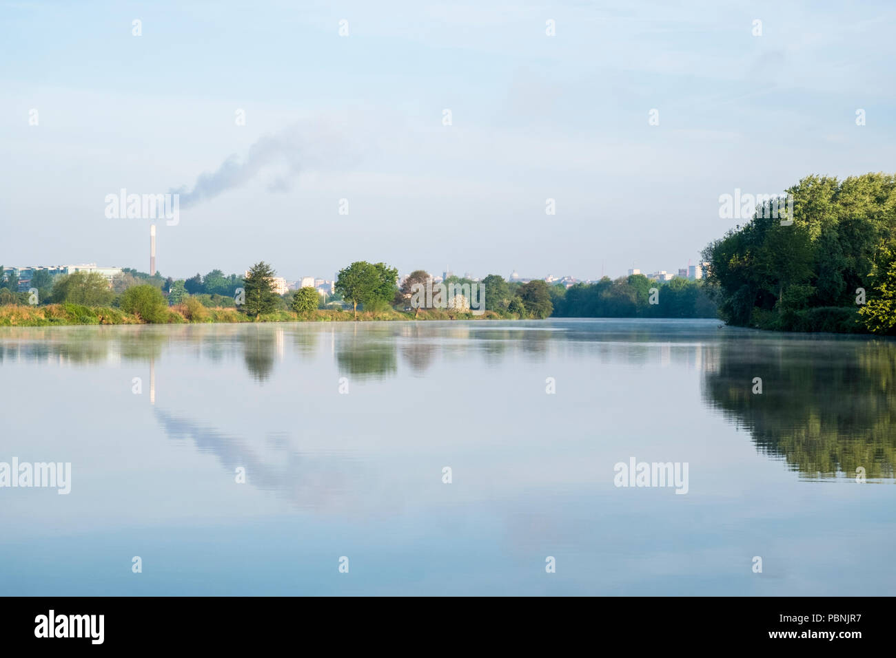Nottingham skyline in the early morning seen from the east on the River Trent, Nottinghamshire, England, UK - Stock Image