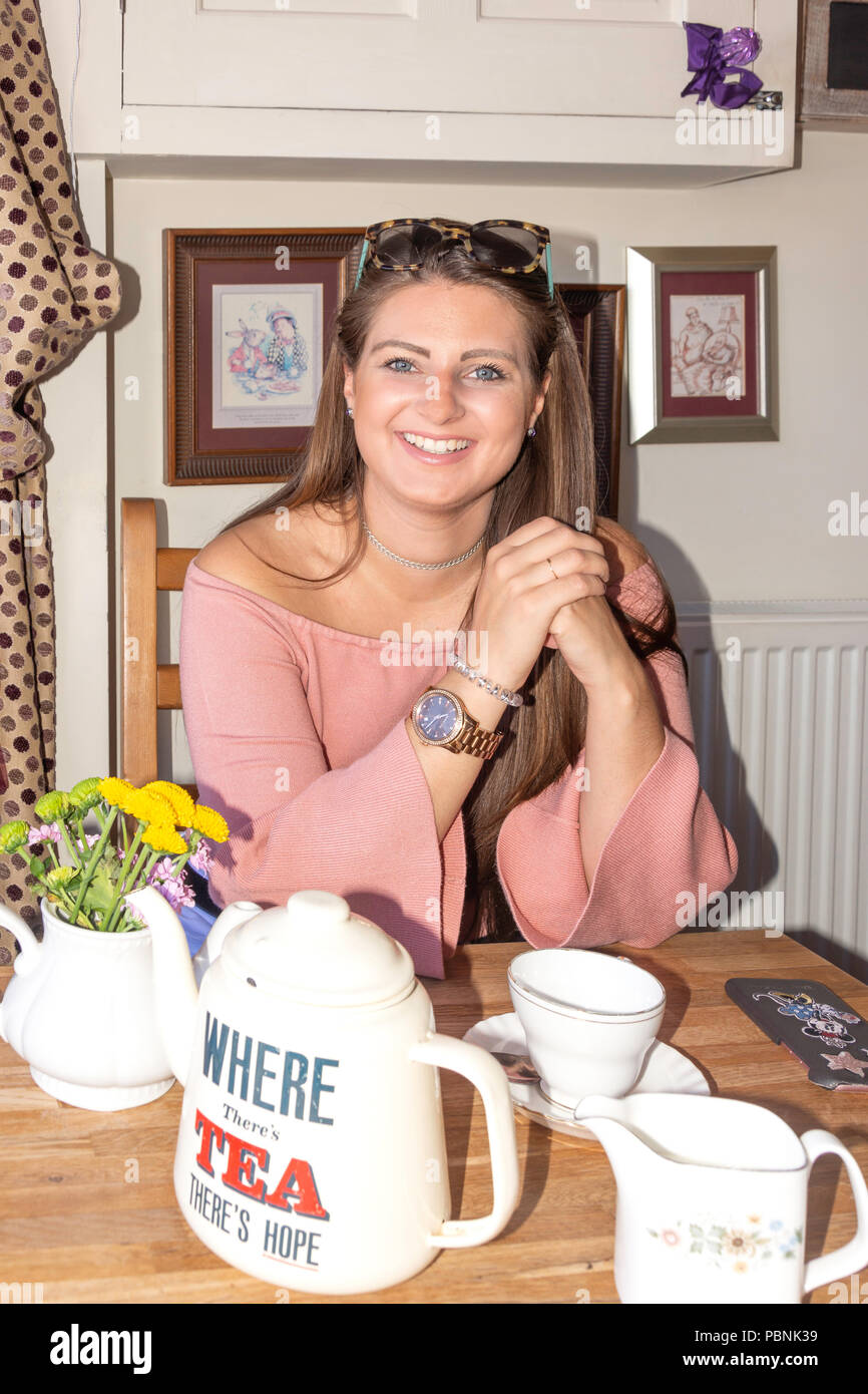 Young woman in The Mad Hatter tea rooms, Sea Road, Seaburn, Sunderland, Tyne and Wear, England, United Kingdom - Stock Image
