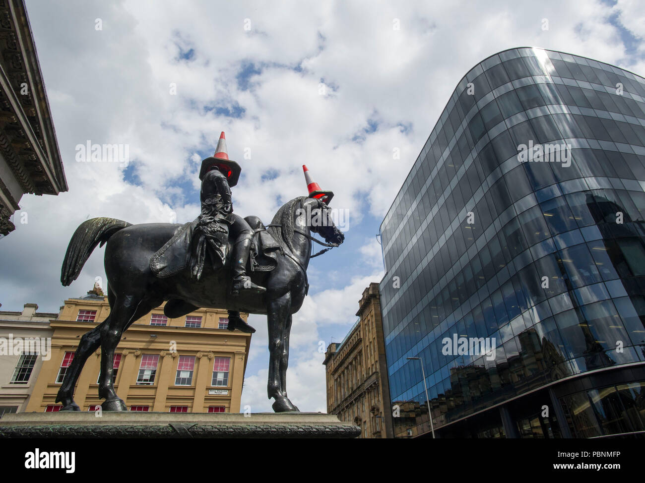 The equestrian Wellington Statue is a statue of Arthur Wellesley, 1st Duke of Wellington, located on Royal Exchange Square in Glasgow, Scotland. - Stock Image