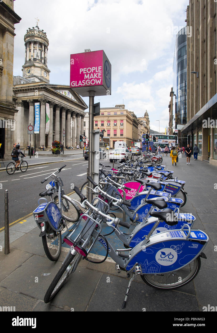 Nextbike bicycles for rent  lined up on a stand in Glasgow city centre. - Stock Image