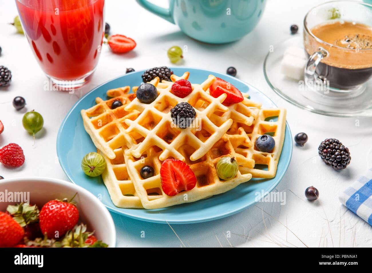 Photo of Viennese wafers, compote, coffee, raspberries, strawberries, gooseberries, cherries - Stock Image