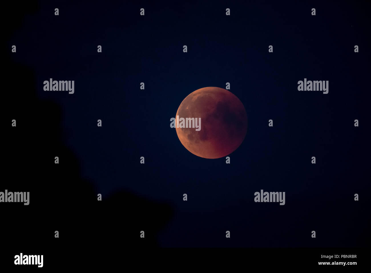 Total Lunar Eclipse, Blood Moon 07/27/2018  23:06  from Hammarskog Uppsala, Sweden. 'The Moon does not have any light of its own—it shines because its - Stock Image