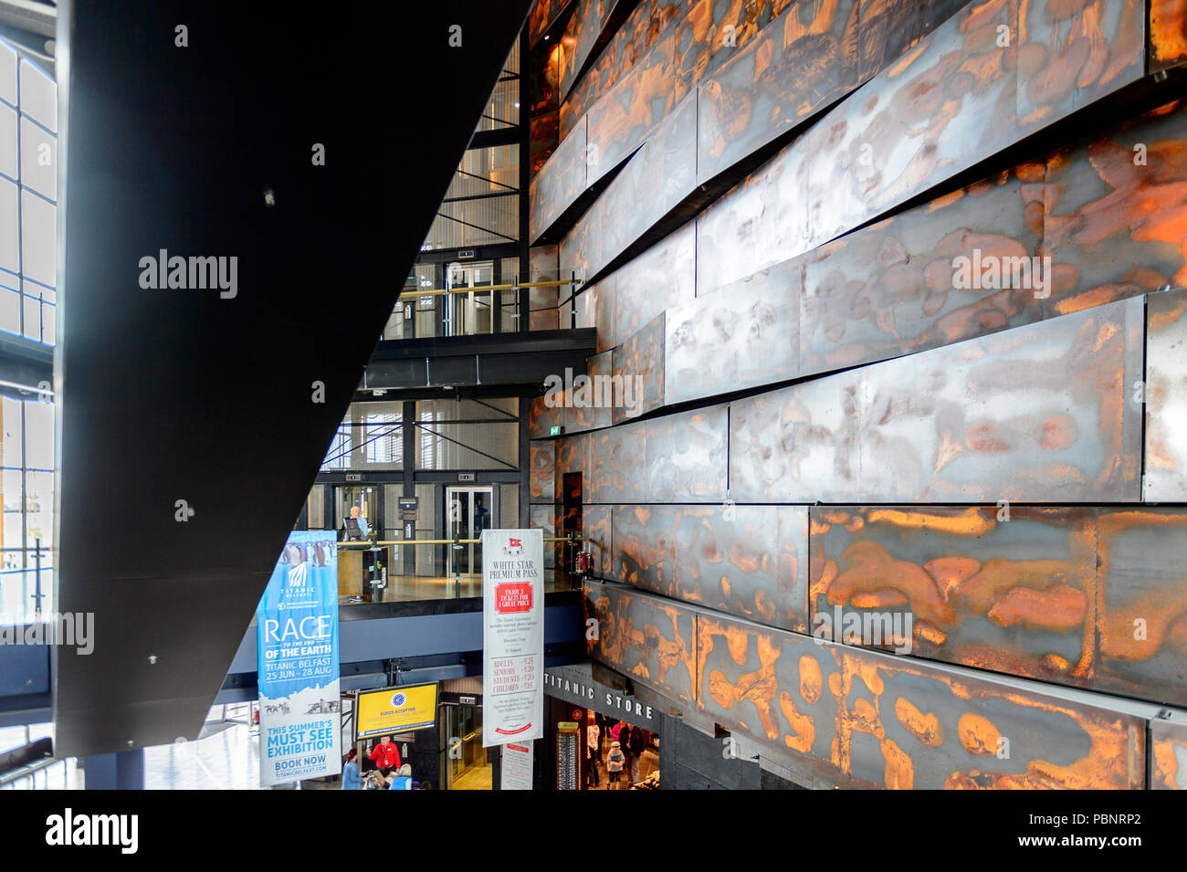 BELFAST, NI - JULY 14, 2016: Interior of the Titanic Belfast, visitor attraction dedicated to the RMS Tinanic, a ship whic sank by hitting an iceberg  - Stock Image