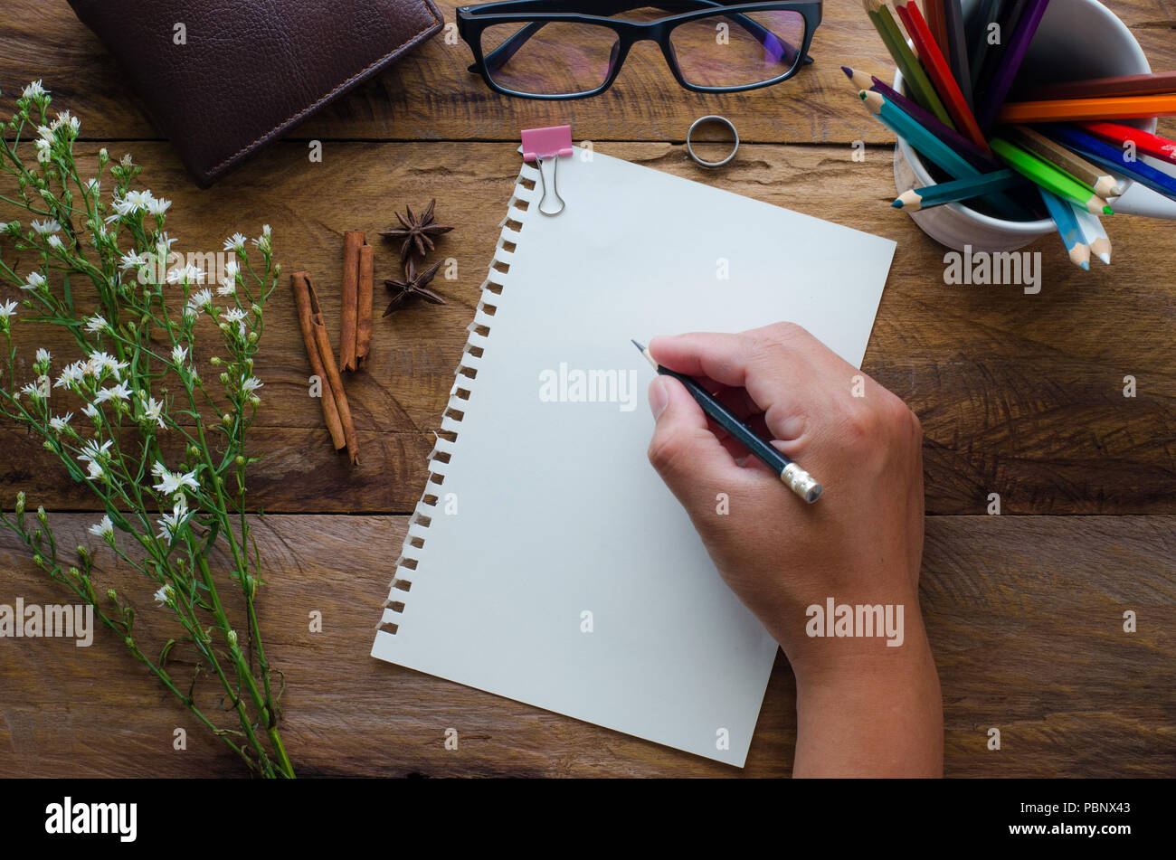 Hand-written note on a wooden table. - Stock Image