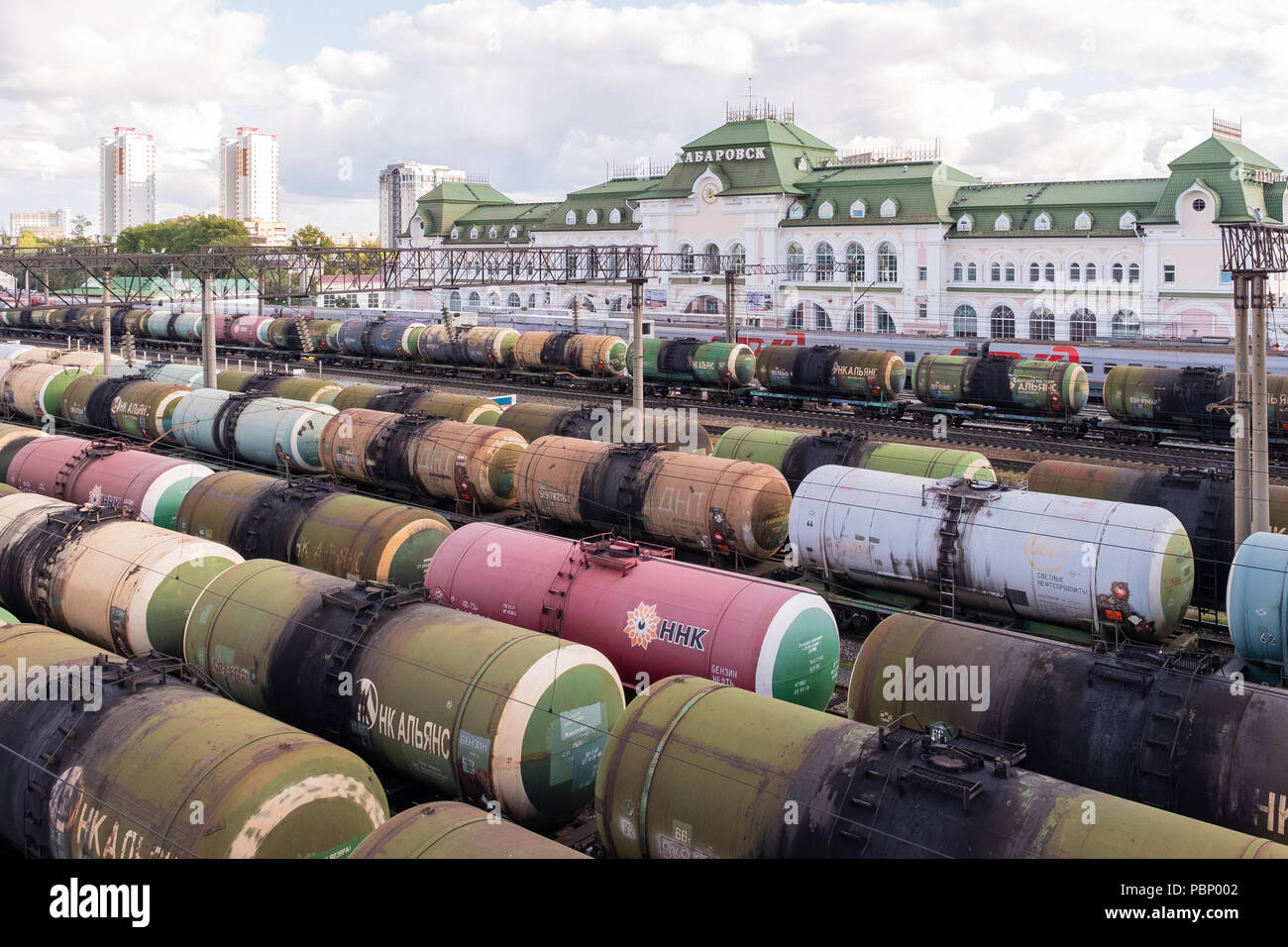 Khabarovsk, Russia - September 1th, 2017: A railway track with the oil tanks and passenger structure standing on it. - Stock Image