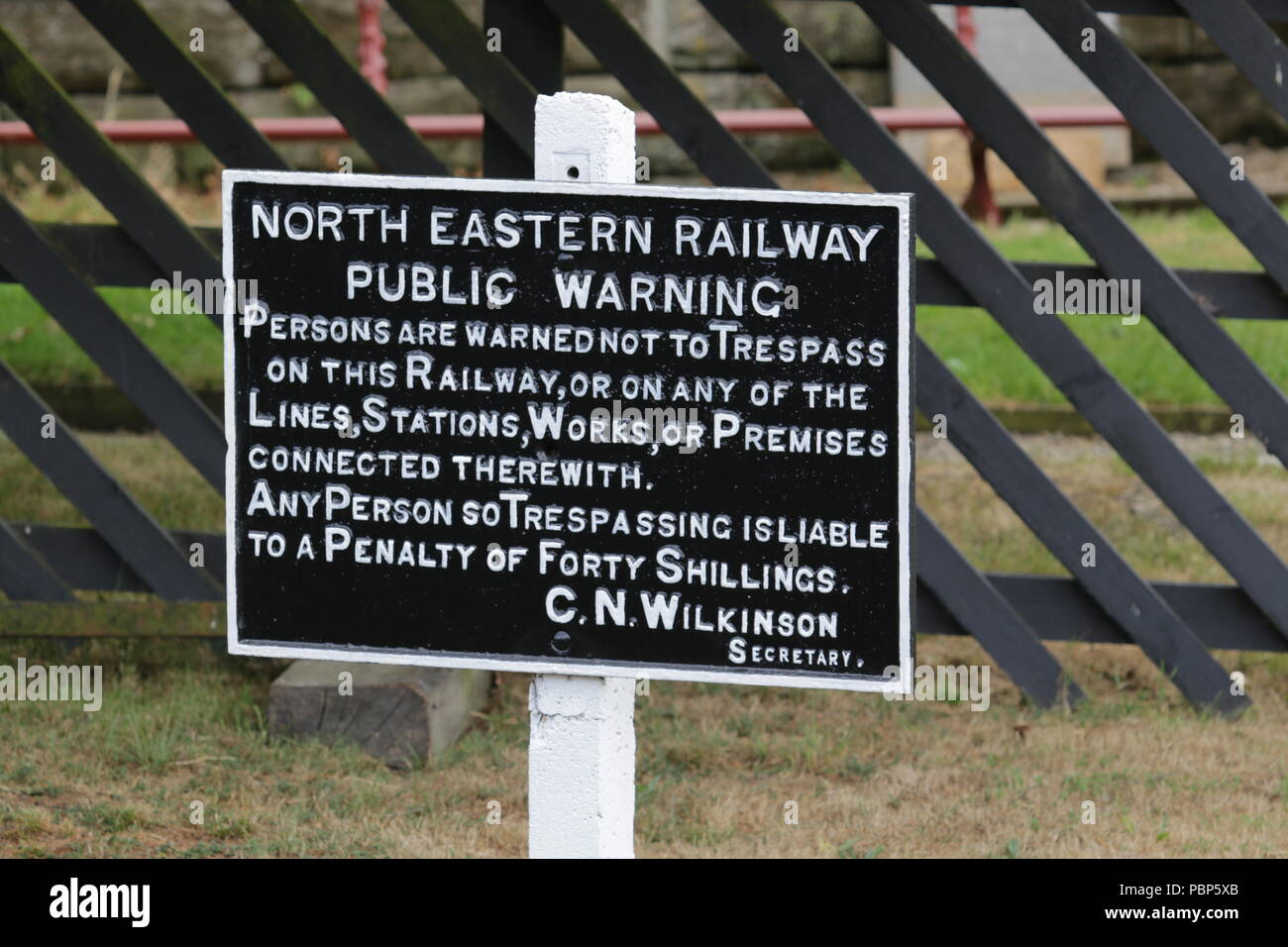 North Eastern Railway cast iron warning sign beside the North Yorkshire Moors Railway - Stock Image