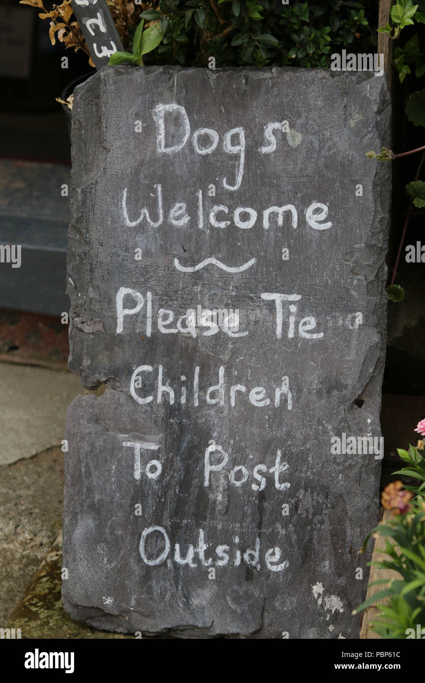 Humourous sign outside a shop in Robin Hood's Bay, Yorkshire - Stock Image
