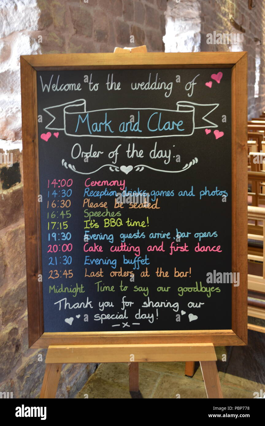 A Board Showing The Order Of The Day For A Wedding Reception In
