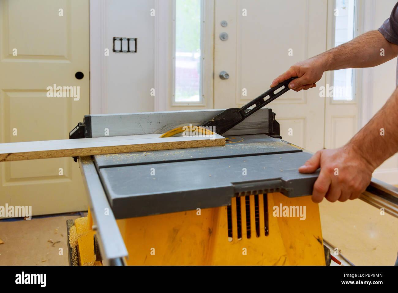 Excellent Carpenter Cutting Wooden Trim Board On With Circular Saw Download Free Architecture Designs Scobabritishbridgeorg