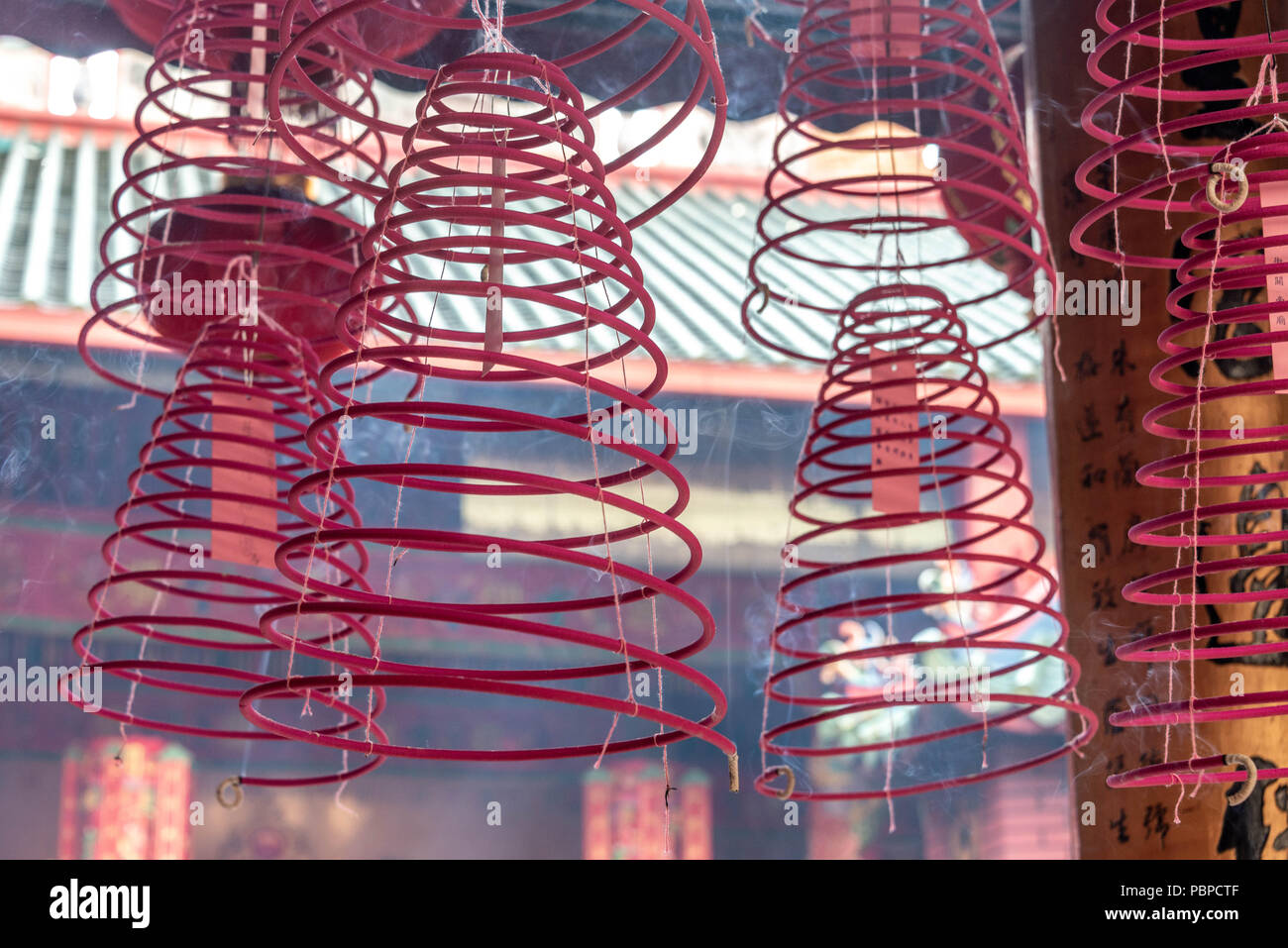 Burning incense coils at a Taoist temple in Kuala Lumpur - Stock Image