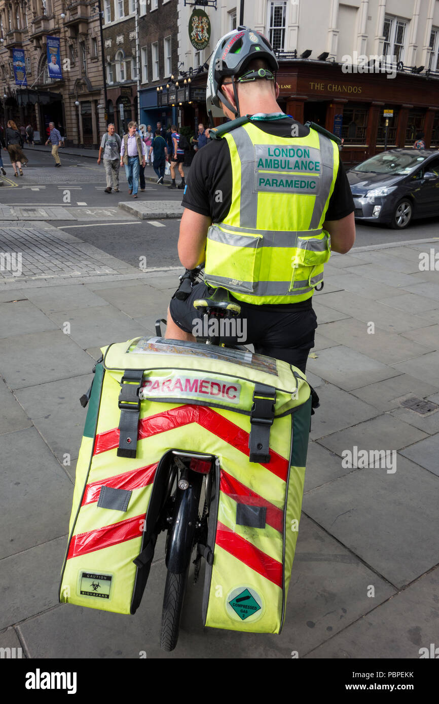London Ambulance Paramedic cyclist on St Martins Lane, London, UK - Stock Image