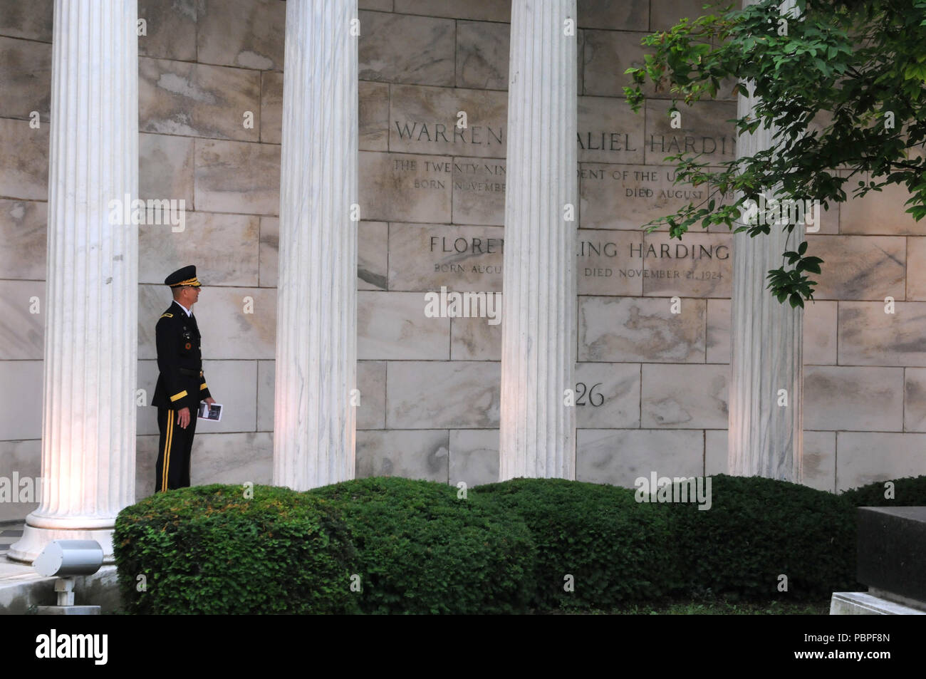 Brigadier Gen. Tony L. Wright, deputy commanding general, 88th Readiness Division, reads the inscription of the Warren G. Harding Tomb in Marion, Ohio, July 21 prior to a wreath laying ceremony honoring the 29th president of the United States. Wright served as President Donald J. Trump's representative for the annual ceremony. Stock Photo