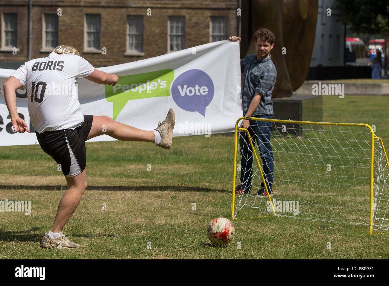 The People's Vote campaign hold World Cup event on College Green to highlight the shambolic state of Brexit on the day the EU Council meets for crunch talks.  Activists from the People's Vote campaign play football on College Green dressed as Brexiters including Boris Johnson, Jacob Rees-Mogg, Nigel Farage and Theresa May.  Featuring: Atmosphere, View Where: London, England, United Kingdom When: 28 Jun 2018 Credit: Wheatley/WENN - Stock Image