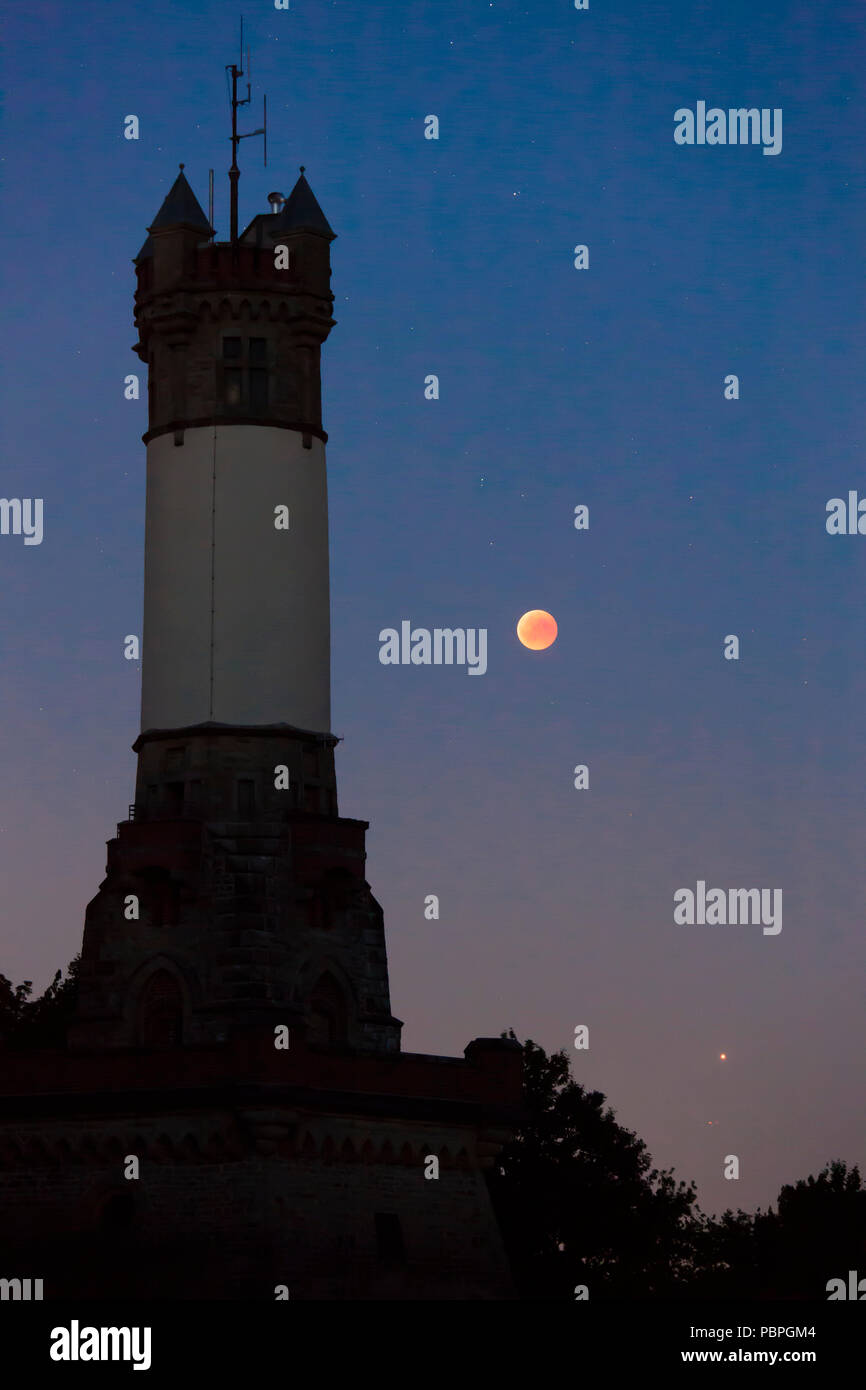 total lunar eclipse over the Harkort Tower in Wetter on the river Ruhr, blood moon, July 27th 2018, bottom right the planet Mars, Germany.  totale Mon - Stock Image