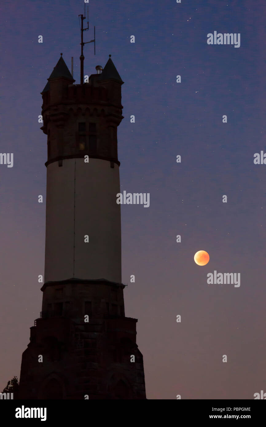 total lunar eclipse over the Harkort Tower in Wetter on the river Ruhr, blood moon, July 27th 2018, Germany.  totale Mondfinsternis ueber dem Harkortt - Stock Image