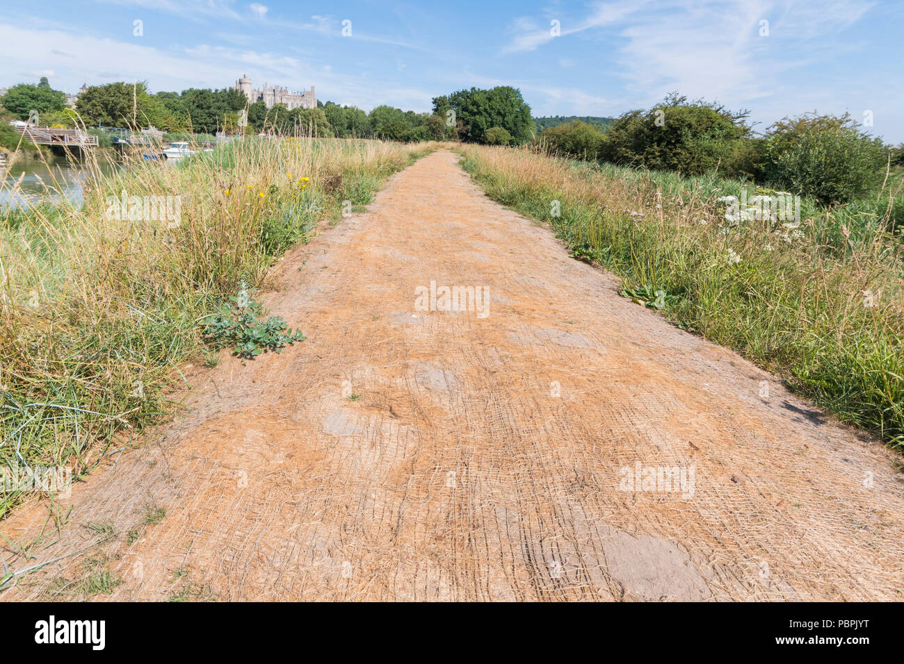 Ground stabilisation mesh on a path that is often muddy, but with a lack of rain for a while, the mud has dried. - Stock Image